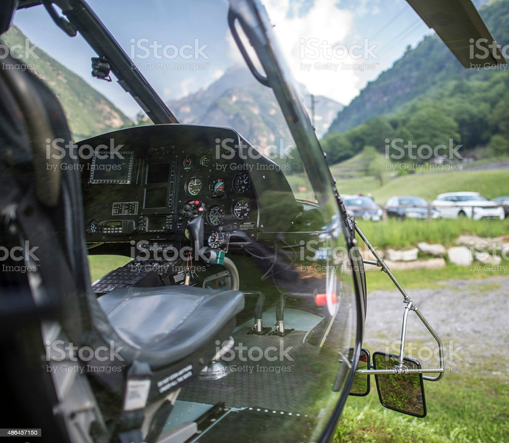 Interior view of helicopter, in grassy field stock photo