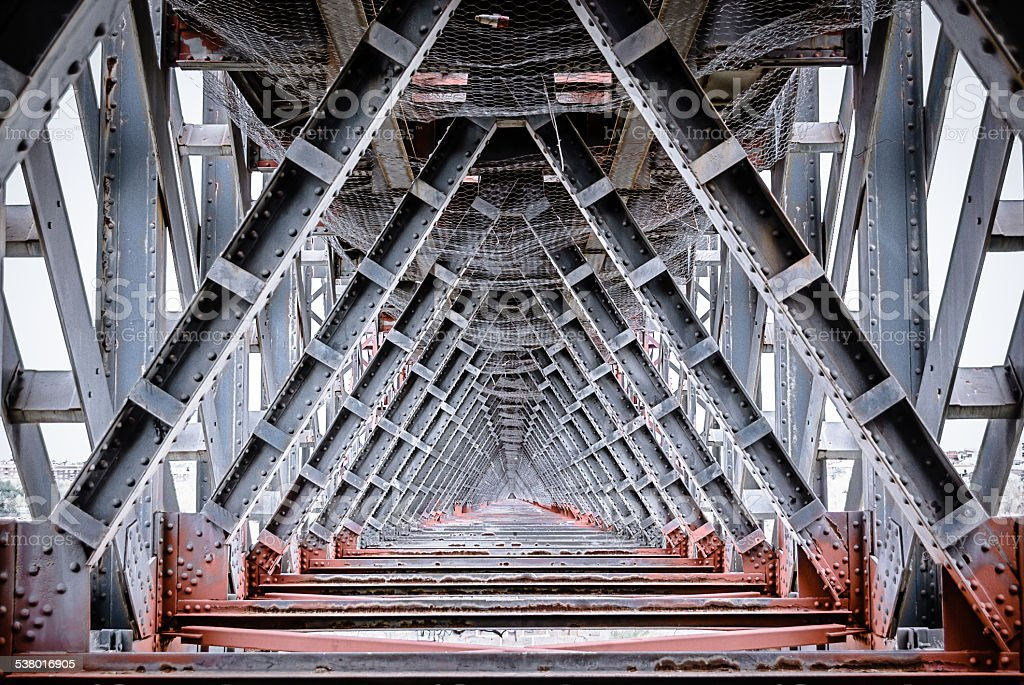 interior view of iron bridge structures with geometric stock photo