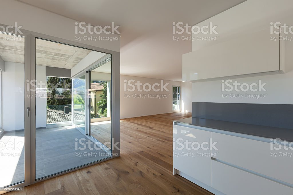 Interior, wide room with domestic kitchen stock photo