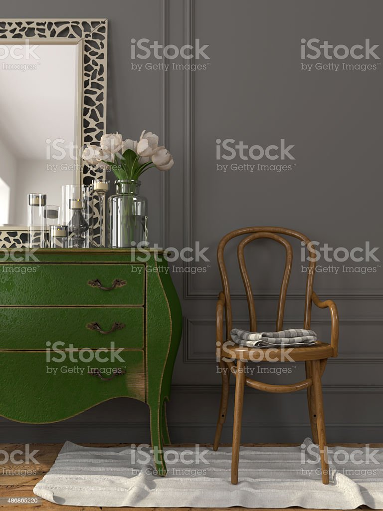 Interior with a green chest of drawers and a wooden chair stock photo