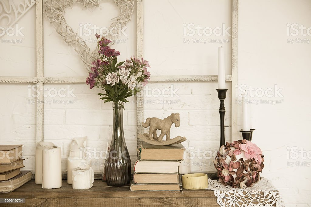Interior with books, flowers and candles stock photo