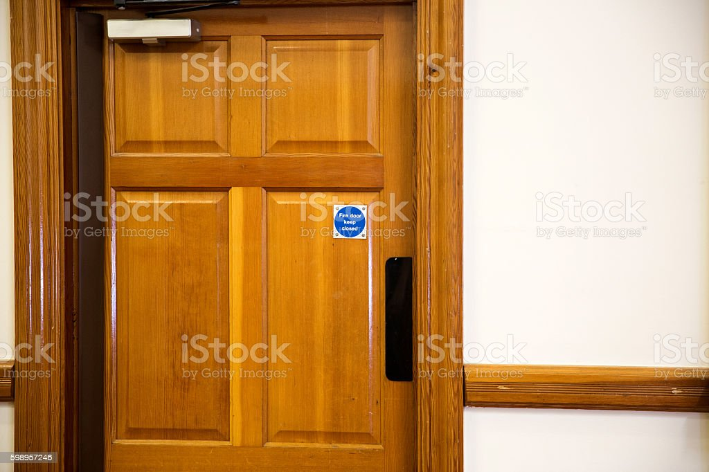 Interior wooden fire door stock photo