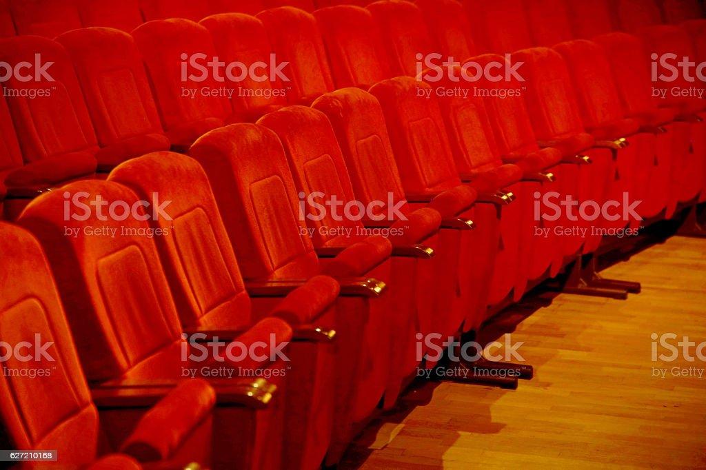 Interiors empty reddish cinema chairs seats in low-key indoors stock photo
