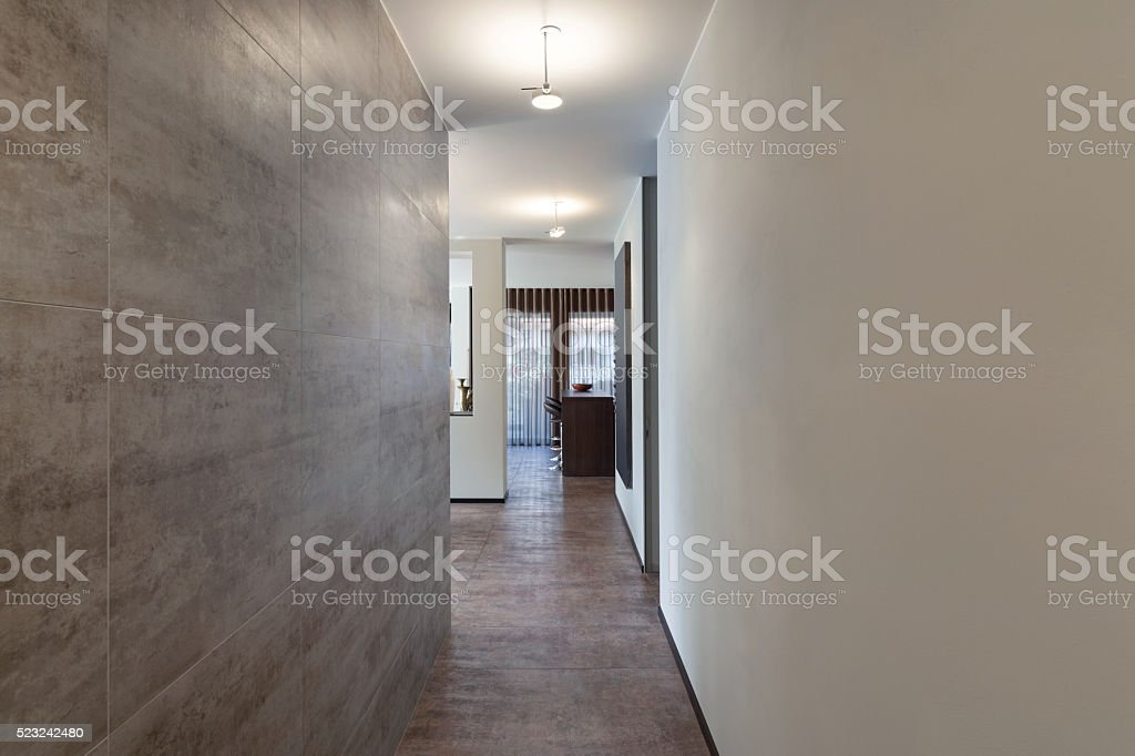 Interiors, long corridor with marble wall stock photo