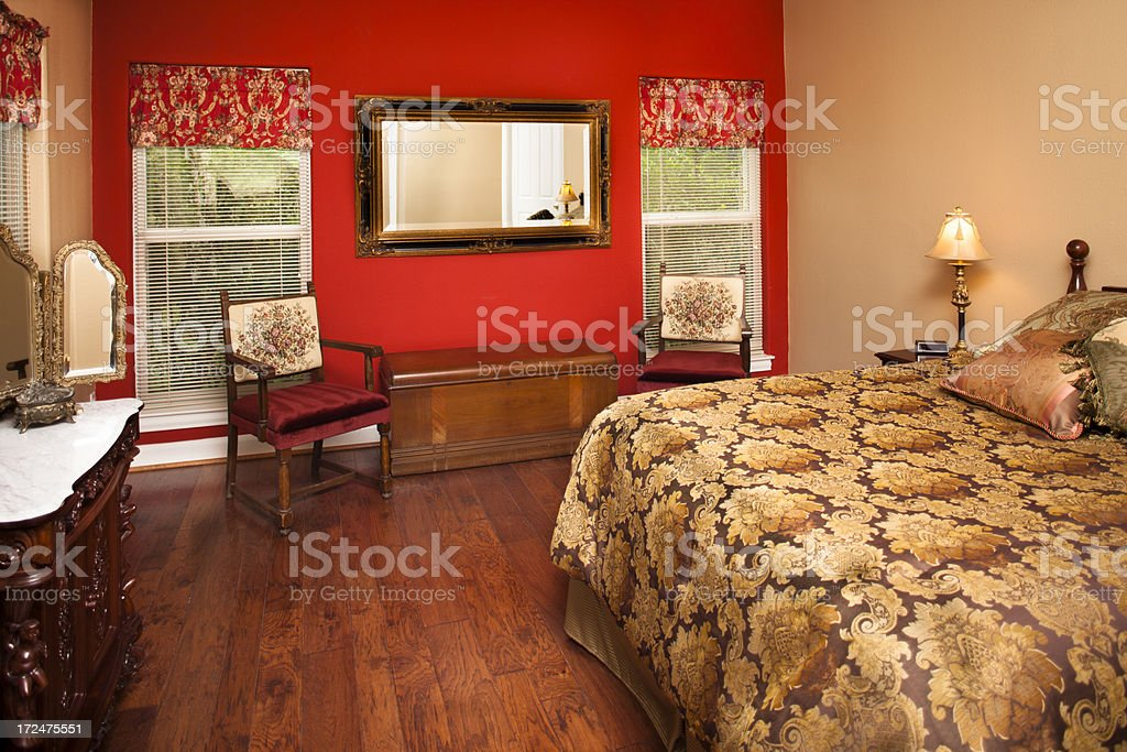 Interiors: Lovely bedroom with hand scraped hardwood flooring royalty-free stock photo
