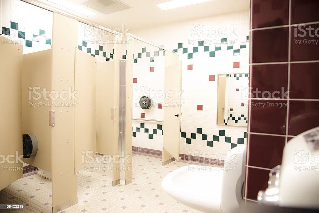 Interiors: Public school girl's bathroom. stock photo