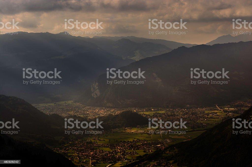 Interlaken village and valley sunbeams sunset stock photo