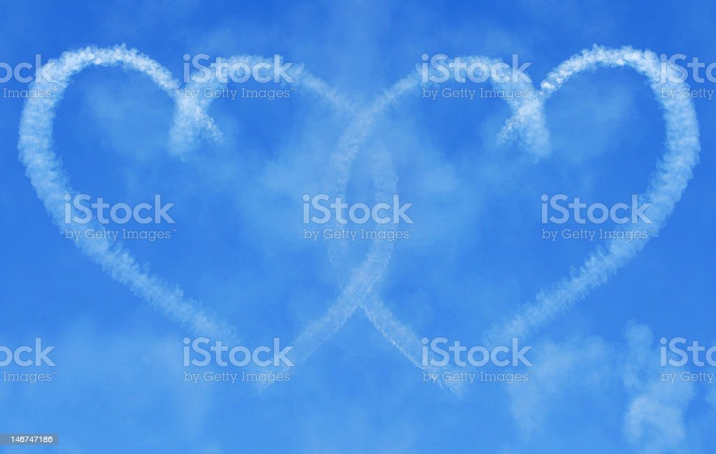 Interlinking Skywriting Hearts stock photo