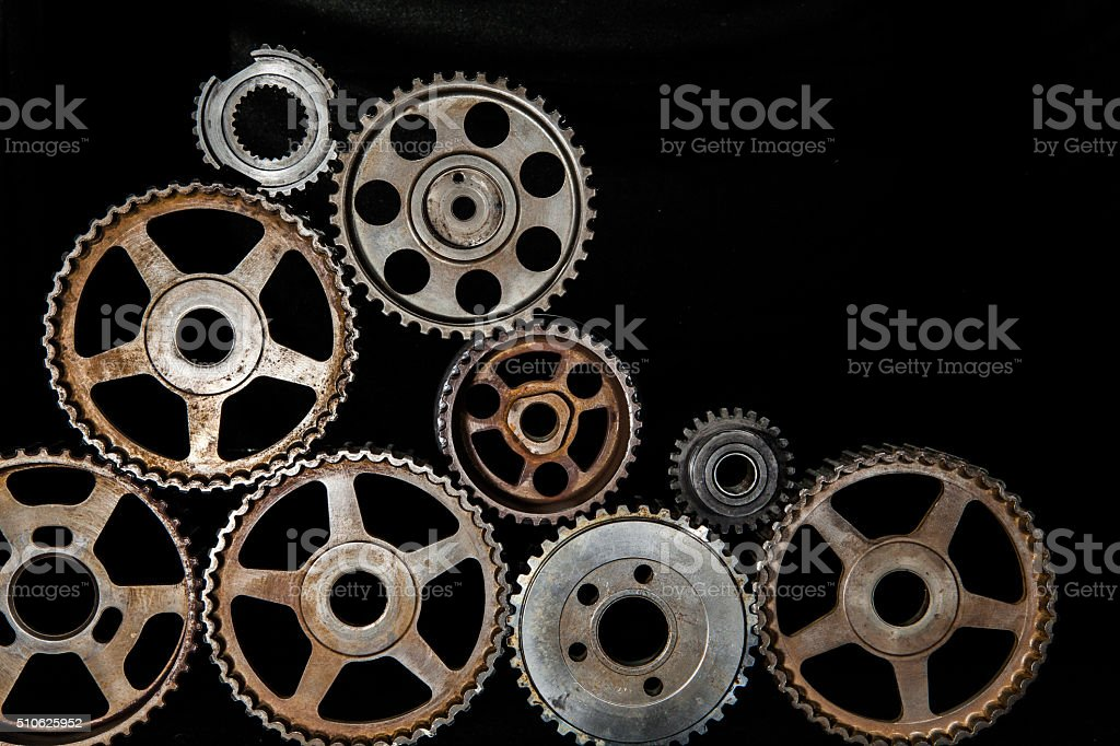 Interlocking industrial  cogwheels top view on black background stock photo