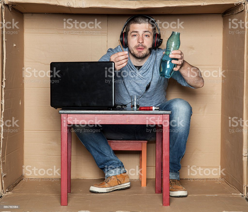intern drink alcohol at work stock photo