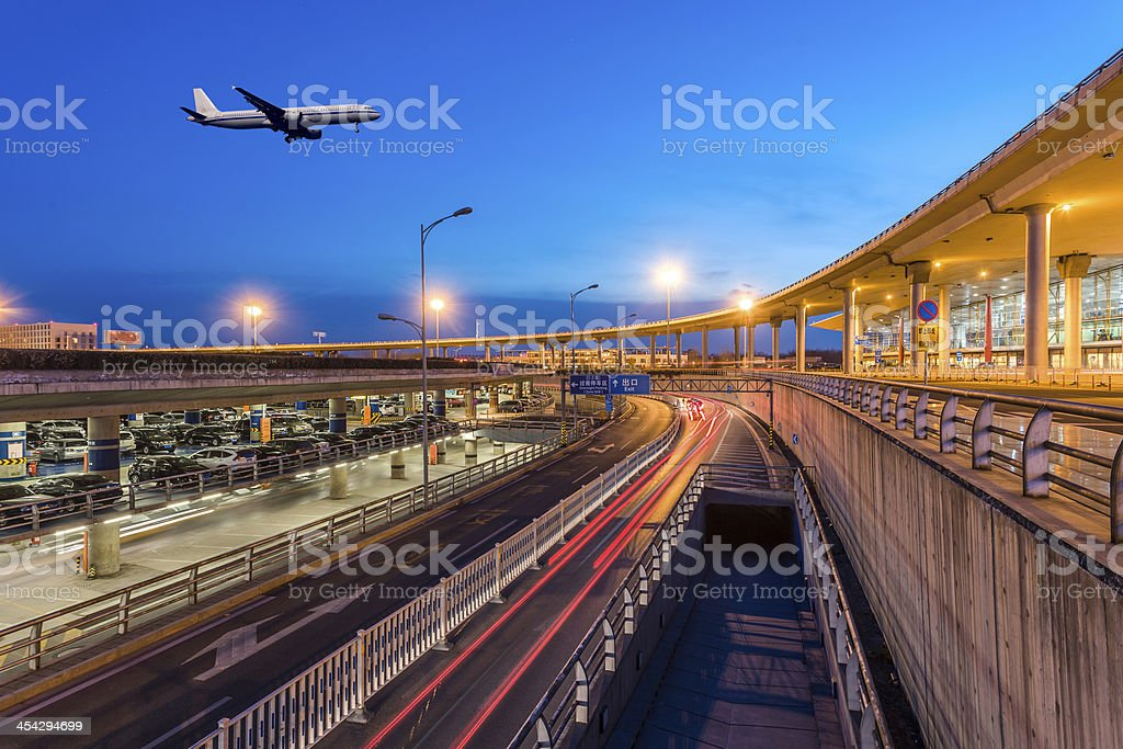 International Airport terminal T3 Beijing night with plane stock photo