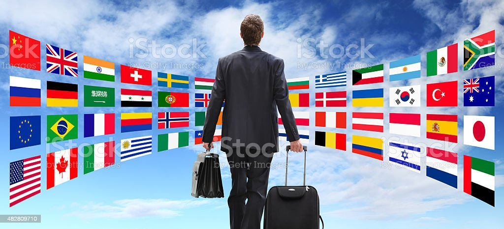 International business man travel with trolley, global business concept stock photo