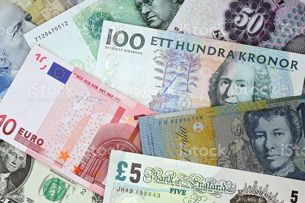 International currencies : Euro, Pound, Dollar, Kroner banknotes topview stock photo