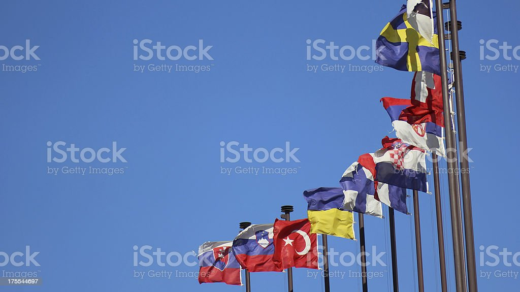 international flags and sun in the blue sky stock photo