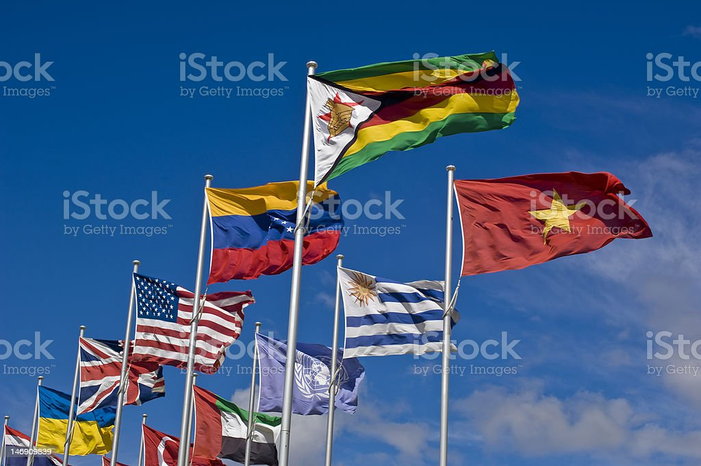 International Flags Blowing against Blue Sky royalty-free stock photo