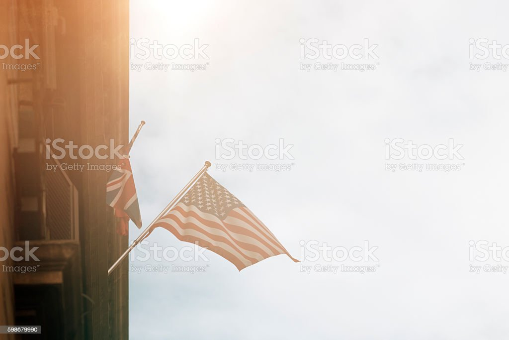 international flags hanging on building stock photo