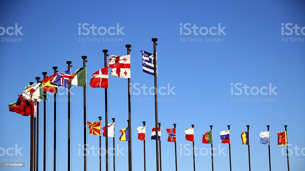 international flags on a background of blue sky stock photo