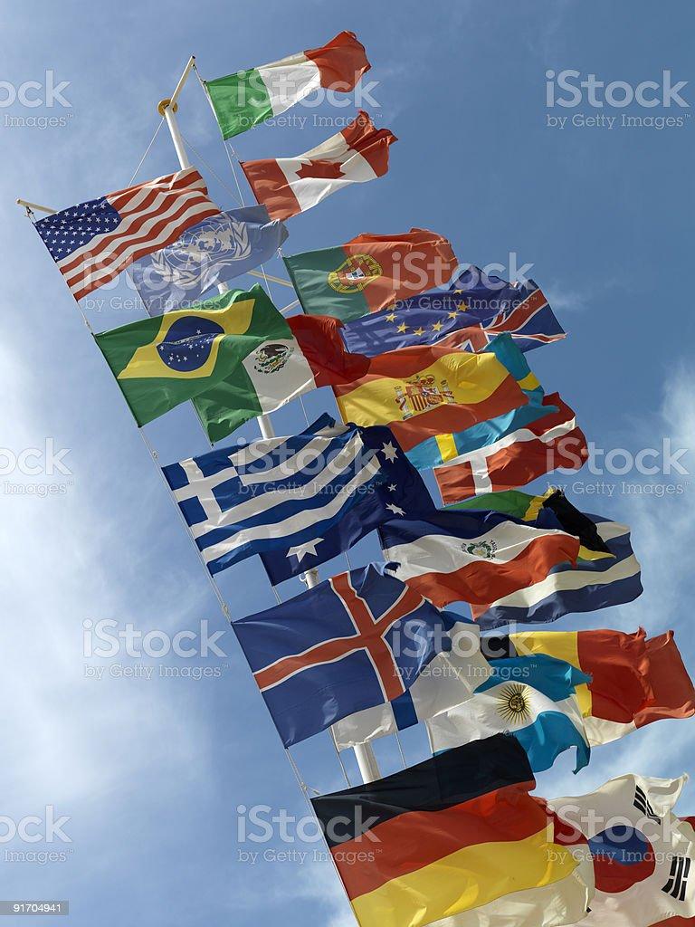 International flags on a pole waving outside royalty-free stock photo