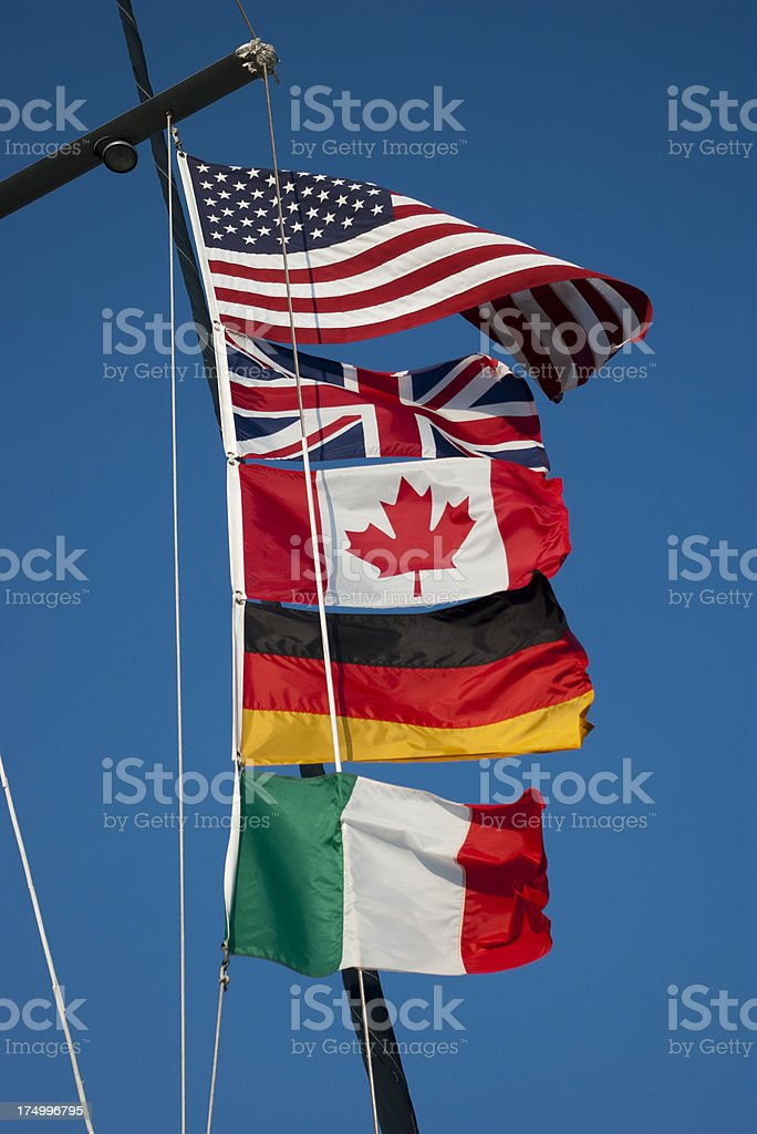 International Flags Wave above a sailing vessel royalty-free stock photo