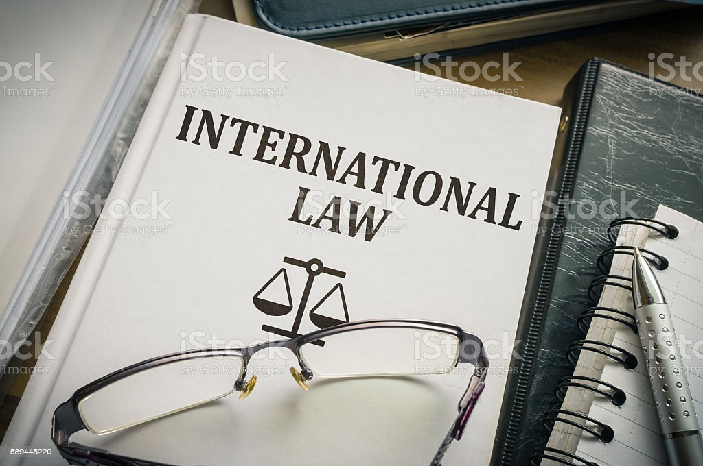 International law book. Legislation and justice concept. stock photo