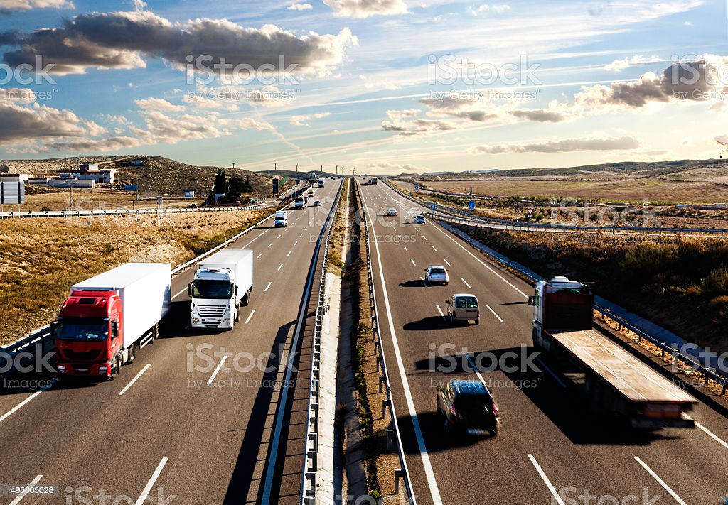 International lorry shipment.Highway and traffic stock photo