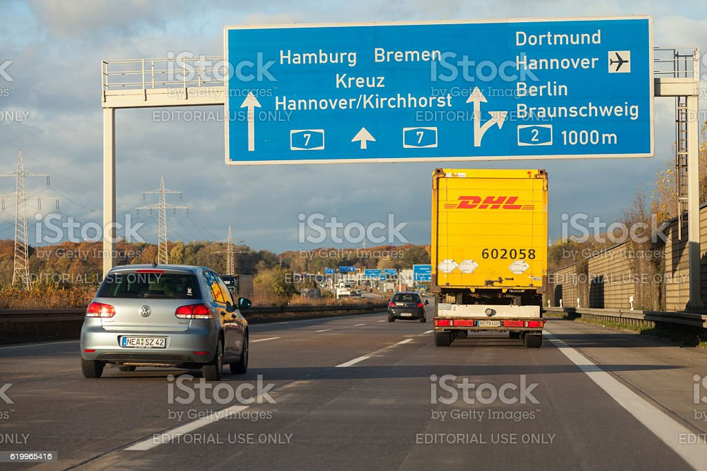 international parcel service DHL truck, drives on german freeway stock photo