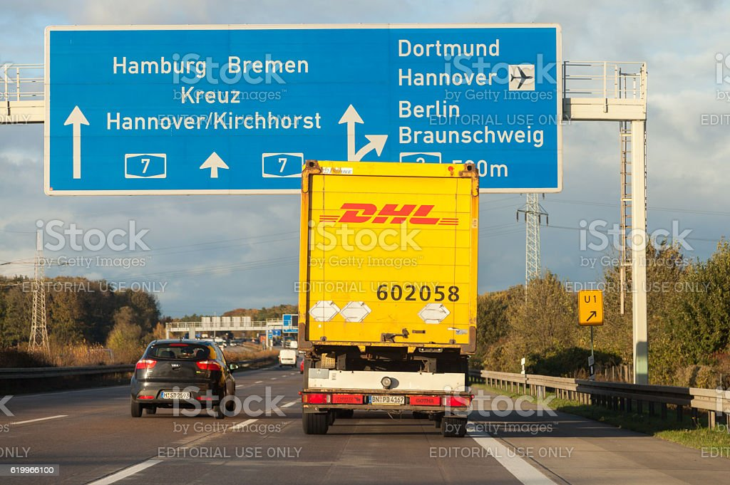 international parcel service DHL truck, drives on german freeway stock photo