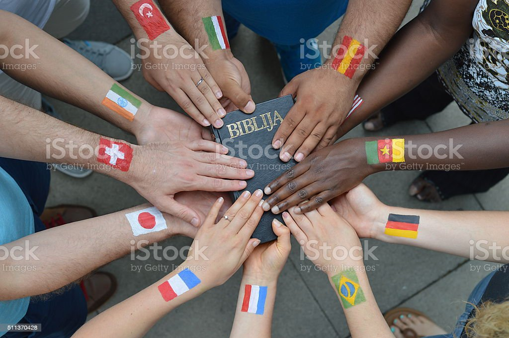 International people holding a bible stock photo