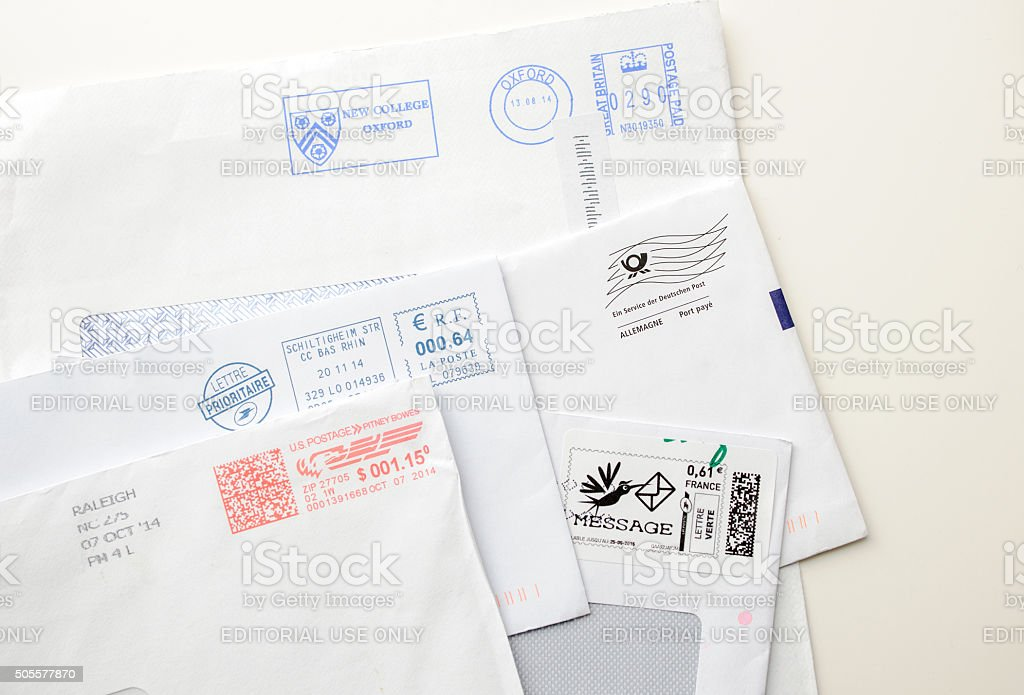 International postage envelopes and stamps stock photo