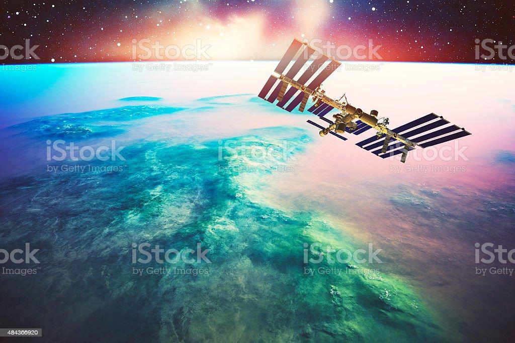 International Space Station orbiting Earth like planet stock photo