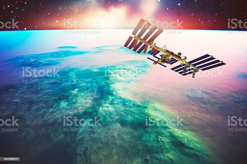 International Space Station orbiting Earth like planet stock photo