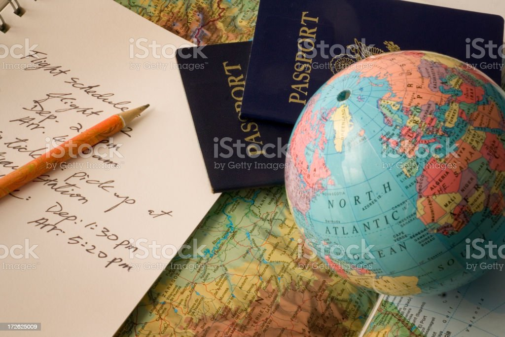 International Vacation Travel Planning with Passport, Globe, Map and Schedule royalty-free stock photo