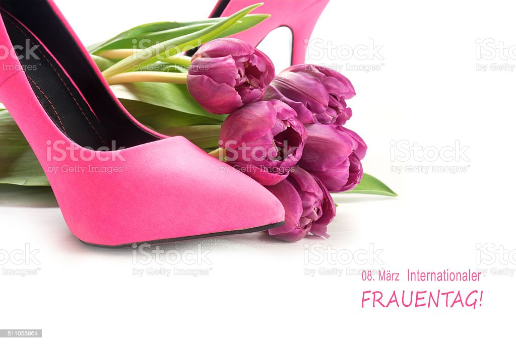 International Women's Day, german text Frauentag, pink shoes and tulips stock photo