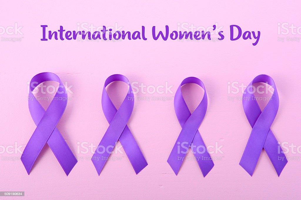 International Womens Day Purple Ribbon Symbol stock photo