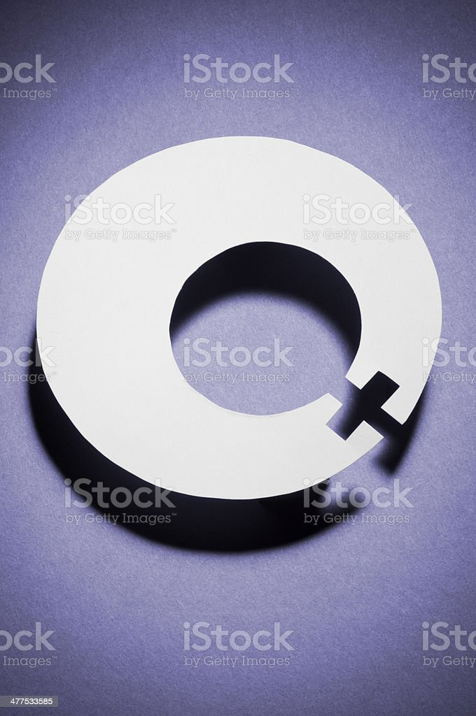 International Women's day symbol on purple stock photo