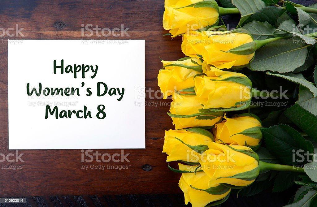 International Womens Day yellow roses gift. stock photo