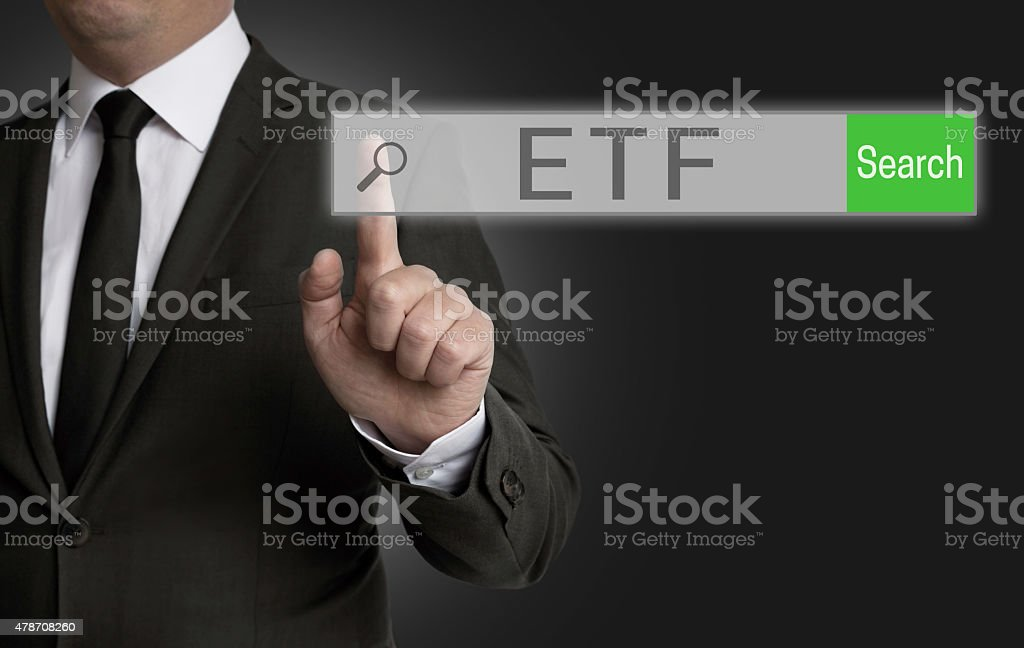 ETF internet browser is operated by businessman stock photo