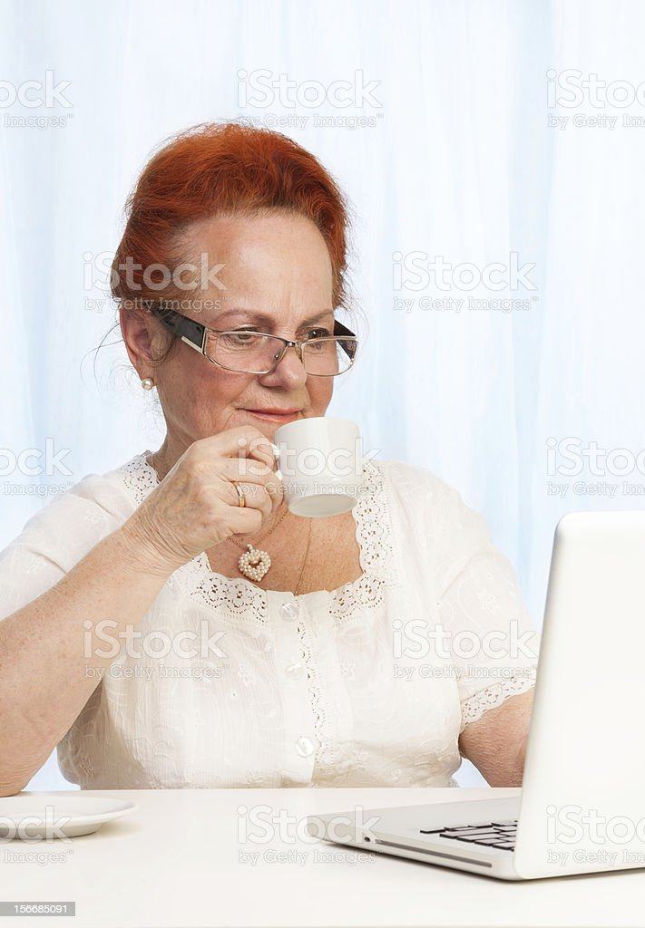 Internet browsing during breakfast royalty-free stock photo
