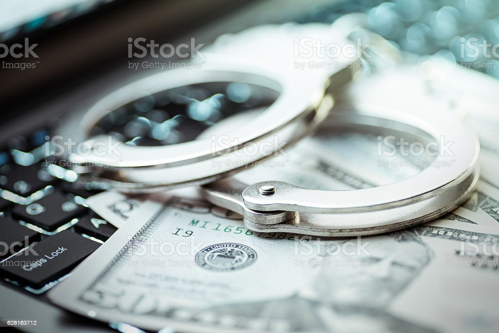 Internet crimes and handcuffs stock photo