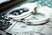 Internet crimes and handcuffs