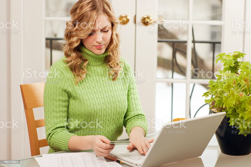 Internet E-commerce, Woman Paying Credit Card Bills with Laptop Computer royalty-free stock photo
