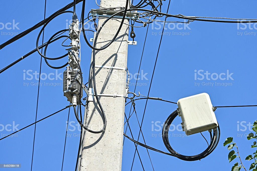 Internet electrical outlet cables on a pole stock photo