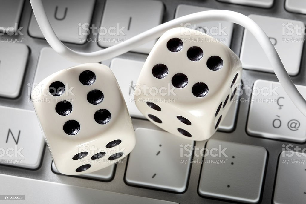 Internet gambling. Nuts on the computer keyboard. stock photo