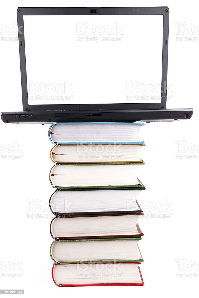 internet library:book stack and laptop isolated on white background royalty-free stock photo