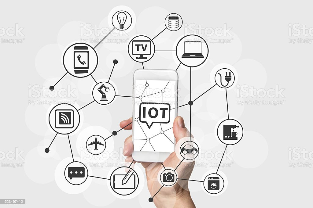 Internet of Things (IOT) concept with hand holding smart phone stock photo