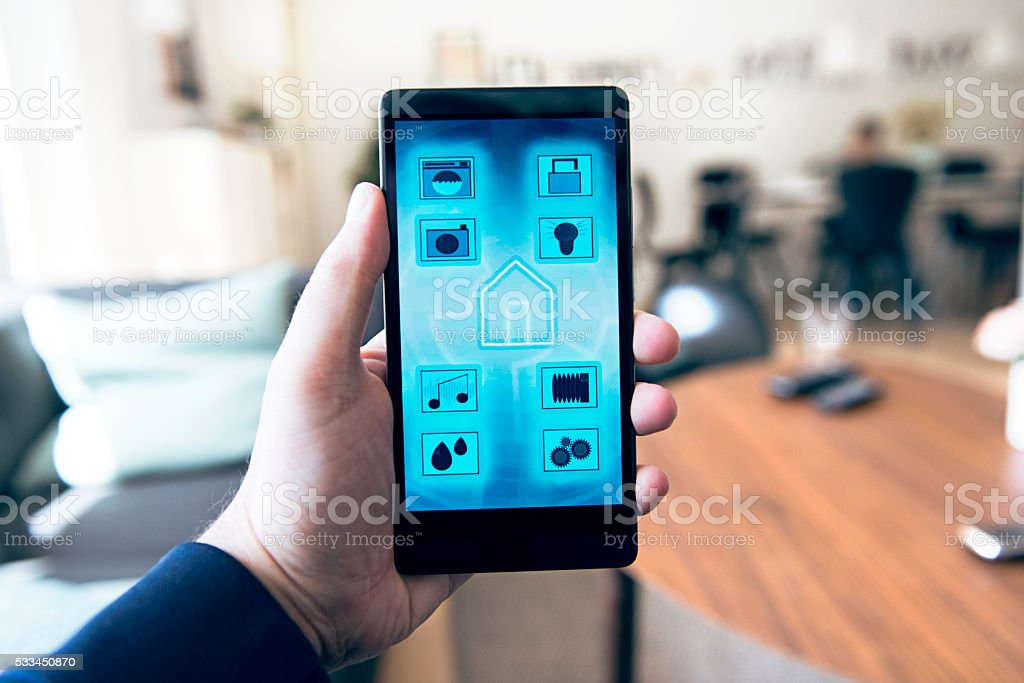 Internet of Things controlled in smart home with mobile app stock photo
