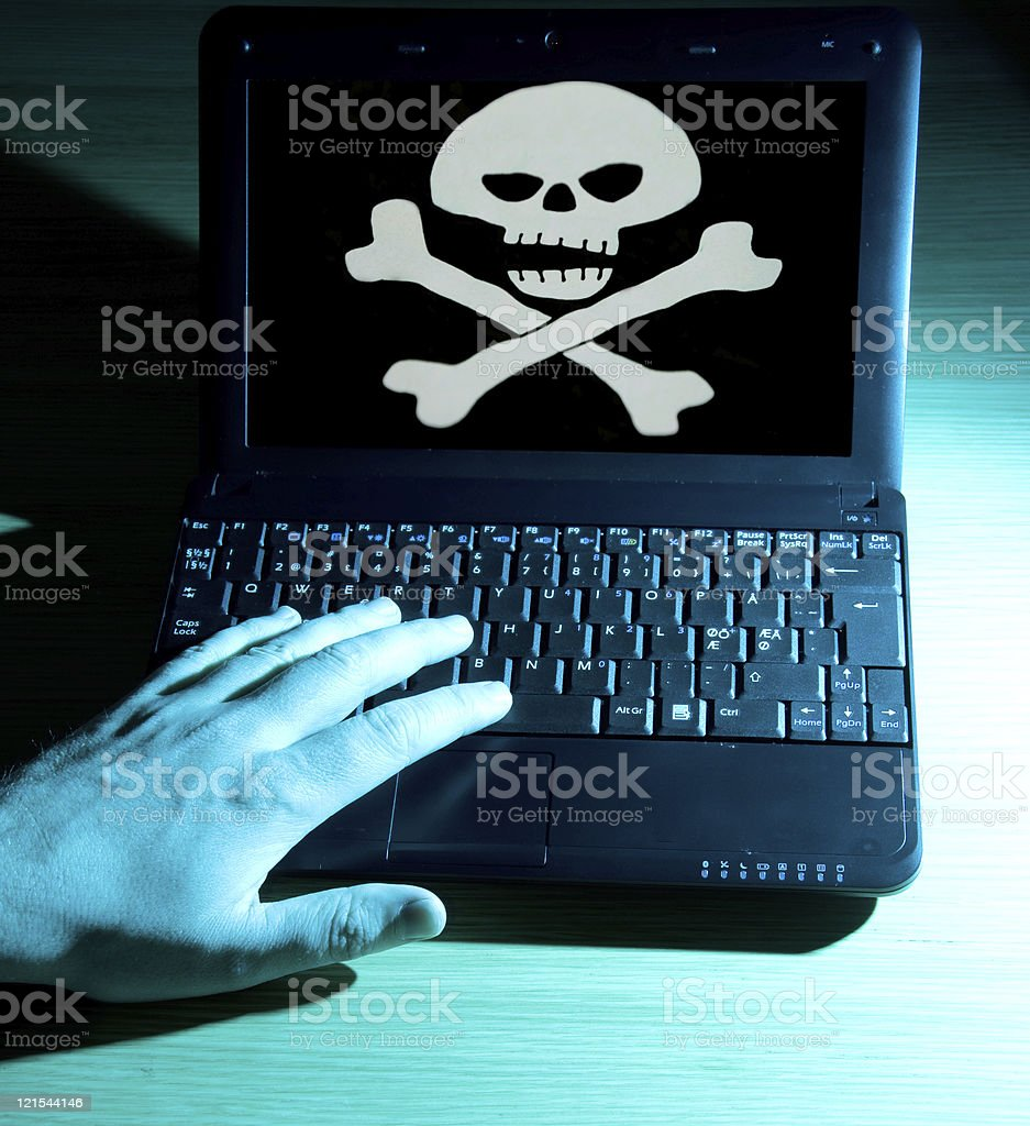 Internet piracy with laptop who shows a skull and bones royalty-free stock photo