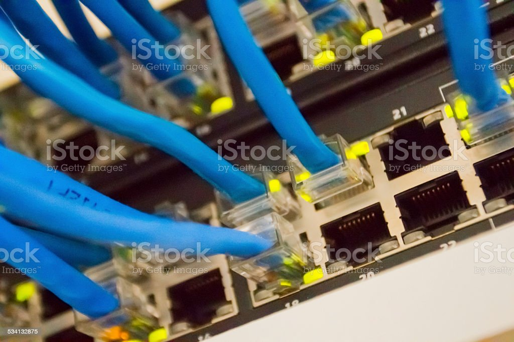 Internet router with cables online with a network hub stock photo