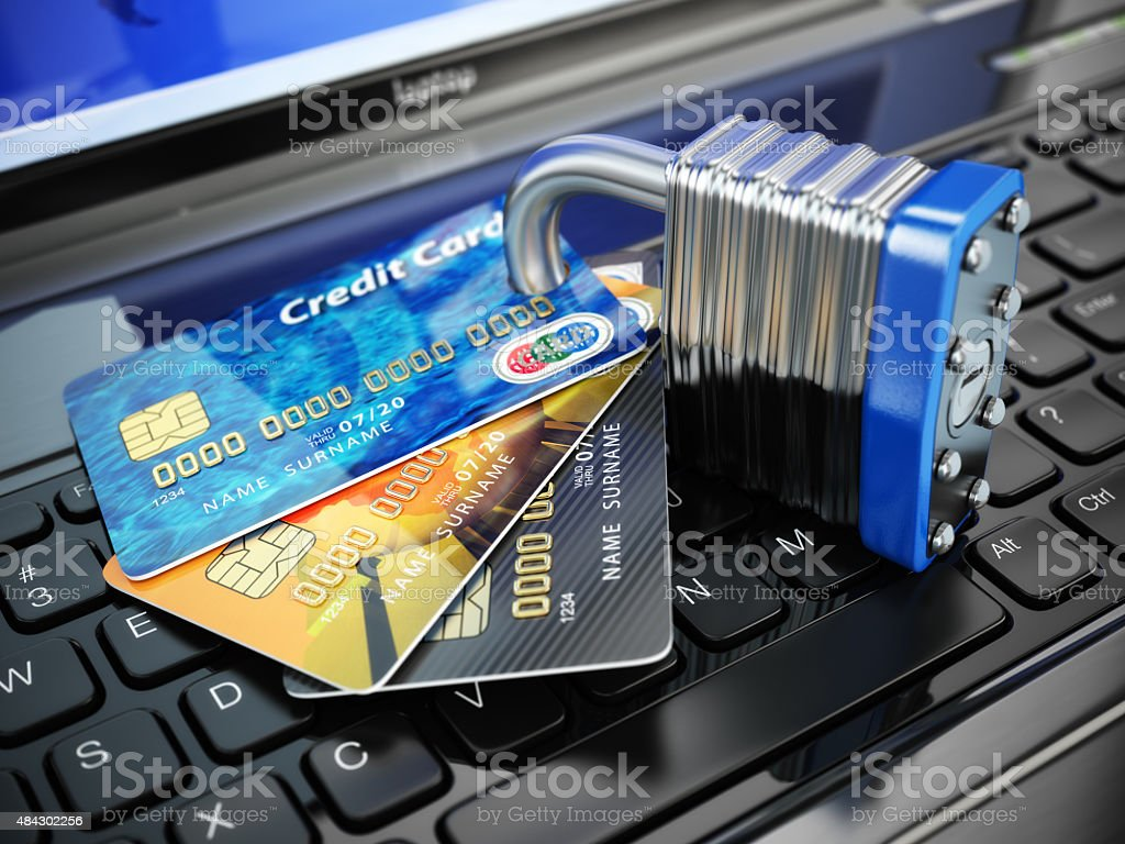 Internet security concept. Credit cards and lock on laptop keybo stock photo