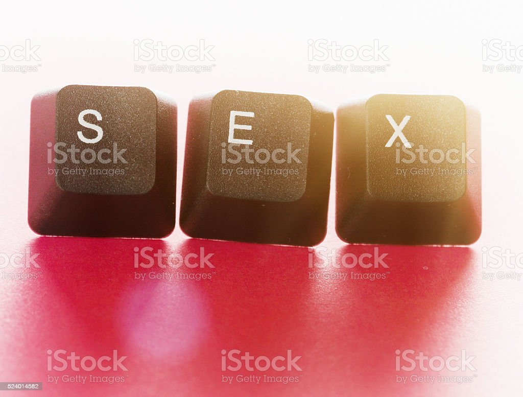 Internet sex: computer keys spell it out stock photo